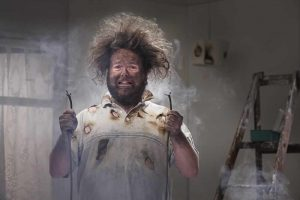 Shocking Advice man with singed hair from handling unsafe electric cables